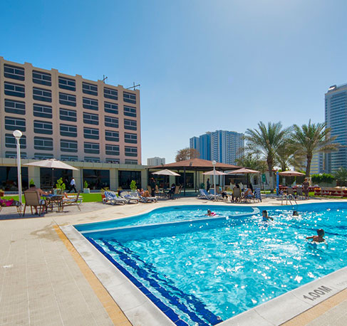 Ajman beach hotel for Public swimming pools in ajman